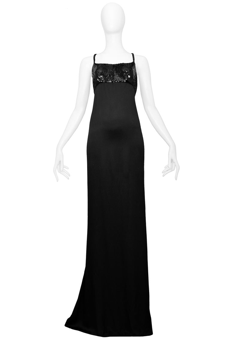Resurrection Vintage is excited to offer this stunning vintage black satin Tom Ford for Gucci evening gown featuring a sequin bodice, criss-cross straps, and back panels, and a side zipper in the back, and an extra-long hem or train. Excellent