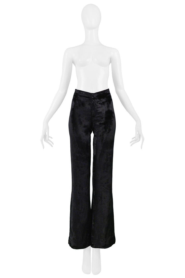 Resurrection Vintage is excited to offer this stunning pair of vintage black Tom Ford for Gucci velvet flare pants with a high waist, center front zipper, and smooth back.  Gucci Designed by Tom Ford Size 38 Velvet Excellent Vintage