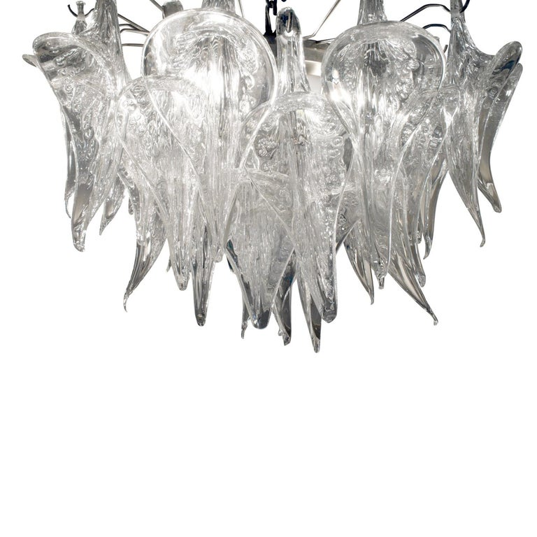 Chandelier with sculptural hand-blown pulegoso glass (with air bubbles) horns, Murano Italy, 1970's. This chandelier is very striking.  H: 17 inches (glass part only) / chain can be adjusted to any height.