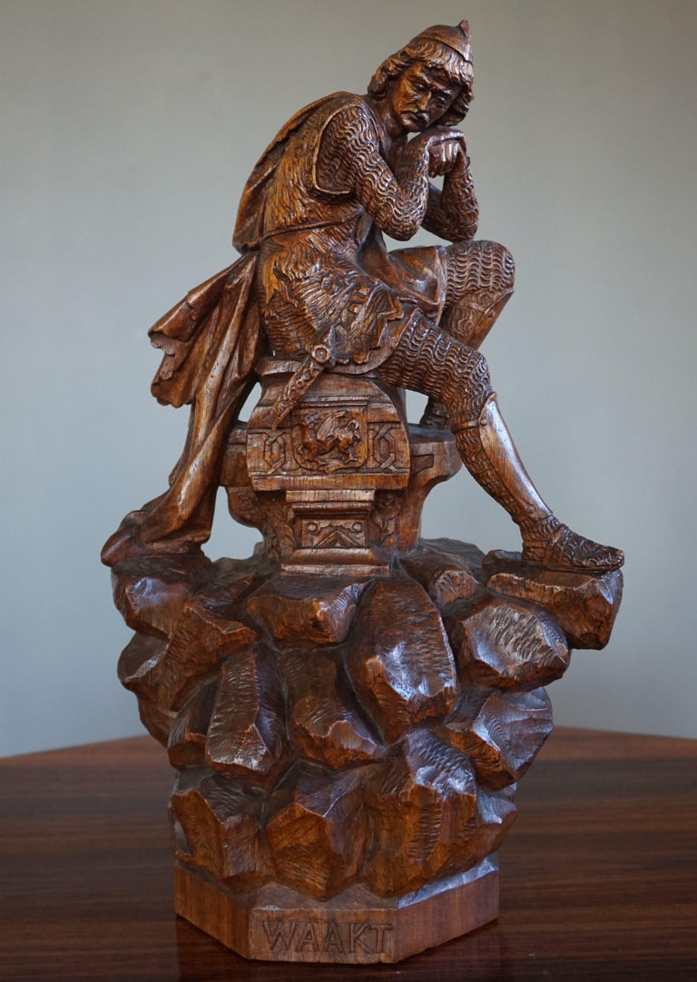 Artistic and highly decorative knight sculpture.  This masterful sculpture is all hand-carved out of a single log of oakwood. Realistic knight sculptures that are hand-carved out of wood are very rare. To have found one of this amazing quality and
