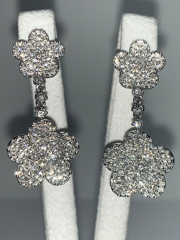 Stunning Handcrafted one-of-a-kind 18K White Gold Diamond Double Flower Earrings. Edgy attention-getting earrings that you will love wearing to your favorite events. 18K White Gold Handmade 2.24 Carat White Diamonds  We specialize in unique,