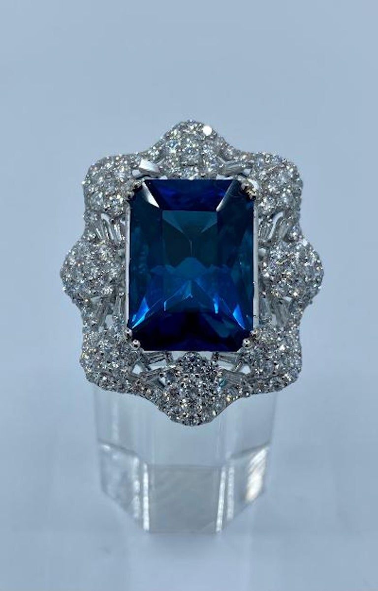 Emerald Cut Stunning Huge 23.71 Carat London Blue Topaz and Diamond 18 Karat Cocktail Ring For Sale