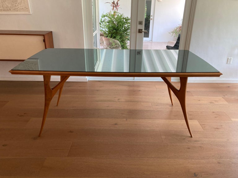 Beautiful 1950s Italian dining table with aqua colored mirror top. Chairs are listed separately.