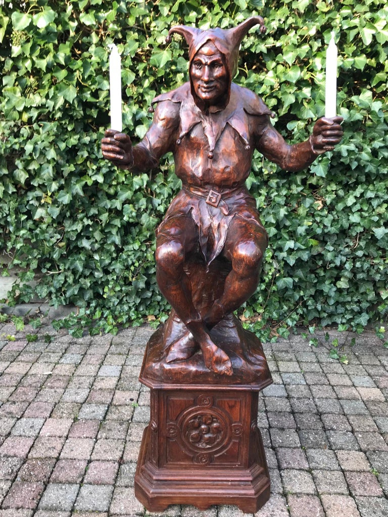 Marvellous antique French jester sculpture.  This large and amazing sculpture of a sitting court jester in the Renaissance Style truly is a rare find. The incredible details in the clothes, his facial features and his perfect body posture tell us