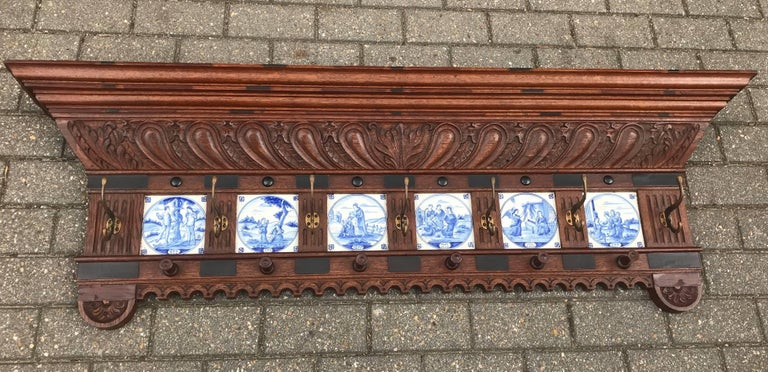 Impressive and all-handcrafted wall coat rack with six delftware tiles.    If you are a collector of rare antiques and religious art referring to the holy bible then this early 19th century, Renaissance Revival wall coat rack could be perfect for