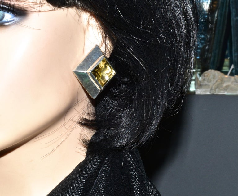 Very Large step cut square natural golden Citrines weighing approximately 20 cts. are set ispiriton these very large sterling silver bold and unusual earrings by the popular and well collected contemporary designer Mark Spirito.  The earrings are 1