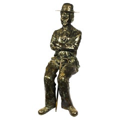 Stunning Life-Size Bronze Sculpture of Seated Charlie Chaplin, 20th Century