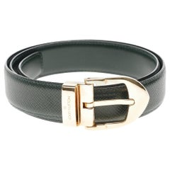 Stunning Louis Vuitton belt in green Taïga leather and golden buckle
