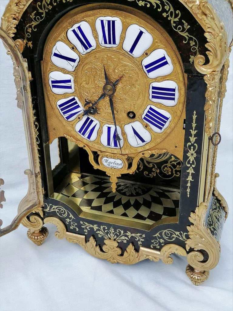 Rare and tall Louis XIV style cartel table clock entirely covered with Boulle style marquetry in engraved brass on a background of brown tortoiseshell.