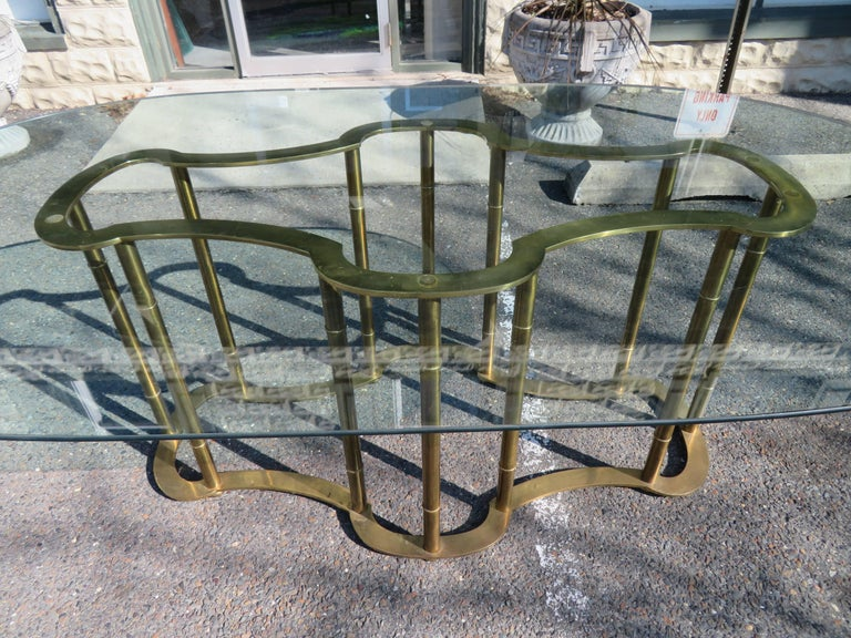Gorgeous brass Mastercraft racetrack table. Faux bamboo vertical supports with flat racetrack top and base.