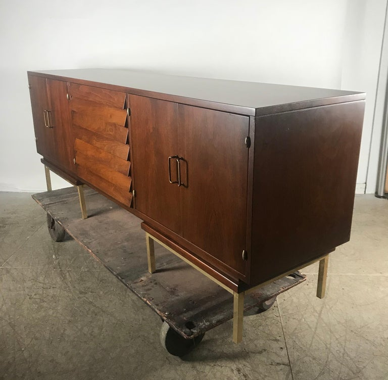 Stunning Mid-Century Modern walnut and brass credenza or sideboard by American of Martinsville. Professionally restored. Superior quality and construction, hand delivery avail to New York City or anywhere en route from Buffalo NY.