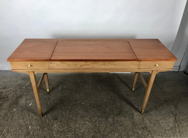 Stunning midcentury desk or vanity, elegant modernist design, extremely versatile, use as desk, vanity with divided storage cubbies and mirror, Classic console or hall table, recently restored top, two-tone finish with modern porcelain pulls,