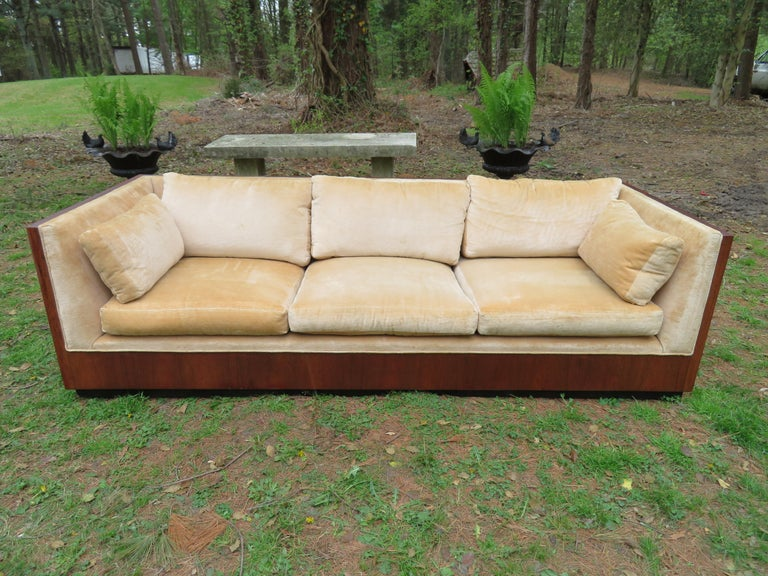 Simply gorgeous Milo Baughman rosewood case sofa. The back is stunning with nicely figured rosewood veneer. This piece retains its original upholstery in presentable condition-can be used as is but as with all vintage fabric we do recommend