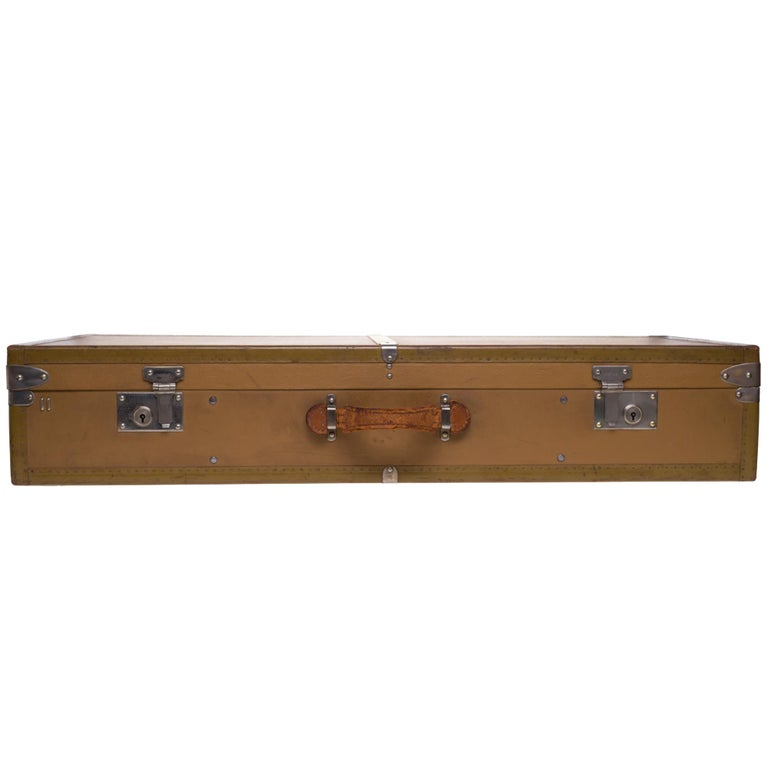 Beautiful decorative and collectible object: MOYNAT suitcase in coated canvas. Metal hardware . Leather handle. Original label. Circa 1930. Dimensions: 77 * 166 * 36 cm.  Good vintage condition despite interior and exterior usage marks on canvas and