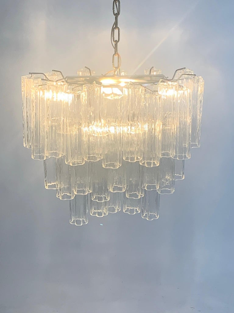 Stunning 1960s chandelier consisting of 43 hanging Murano glass tubes. The frame is nickel and all of the Murano glass is defect free. The fixture gives off a beautiful stunning light and is very impressive in person.