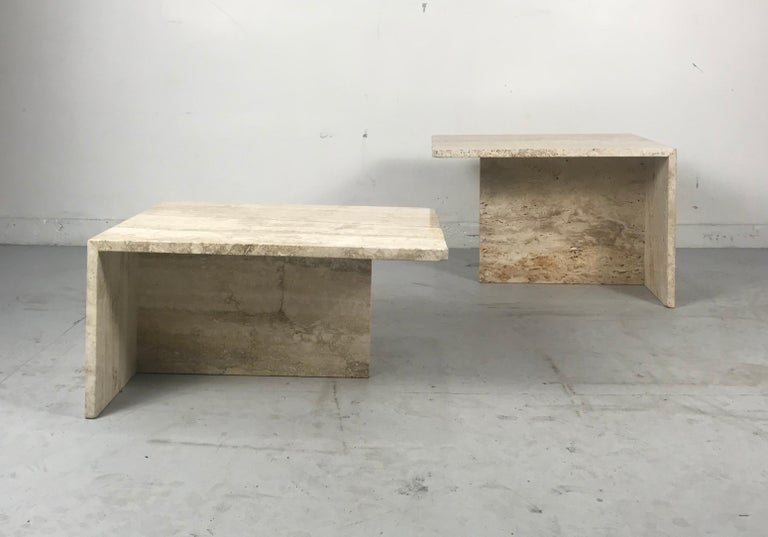 Stunning pair of architectural Italian Modernist travertine tables, Willy Rizzo style, Simple, elegant versatile design, used as coffee/Cocktail Tables, end tables, pedestals. Stands etc. Both tables measure 23
