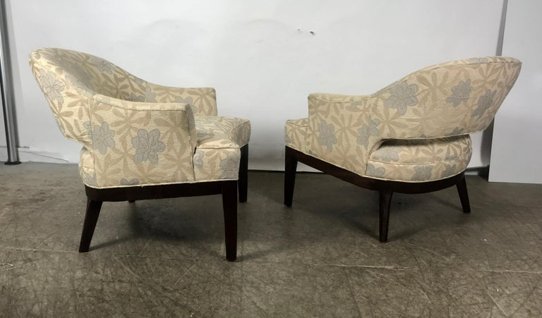 Stunning pair of modernist lounge chairs. Retain original stylized floral fabric. Wonderful condition. Heavy, sturdy solid mahogany frames. Extremely comfortable. Hand delivery avail to New York City or anywhere en route from Buffalo NY.