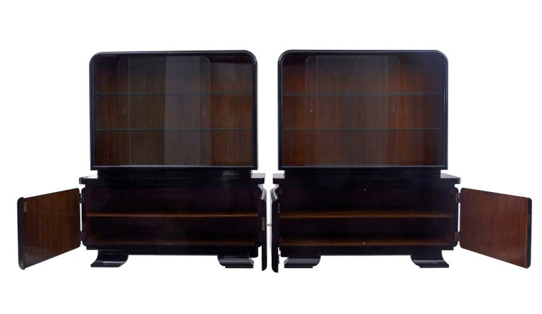 Stunning pair of Art Deco black lacquered sideboard vitrines, circa 1930.
