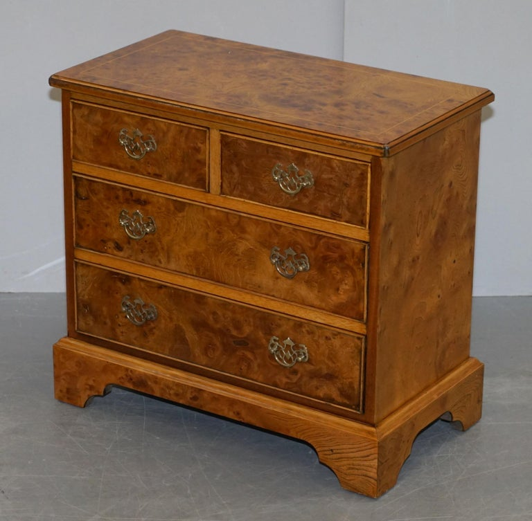We are delighted to offer for sale this exquisite pair of made in England burr & burl walnut & elm bedside table sized chests of drawers.  Ideally suited as lamp or wine tables in a sitting room context or as bedside tables. The timber patina is