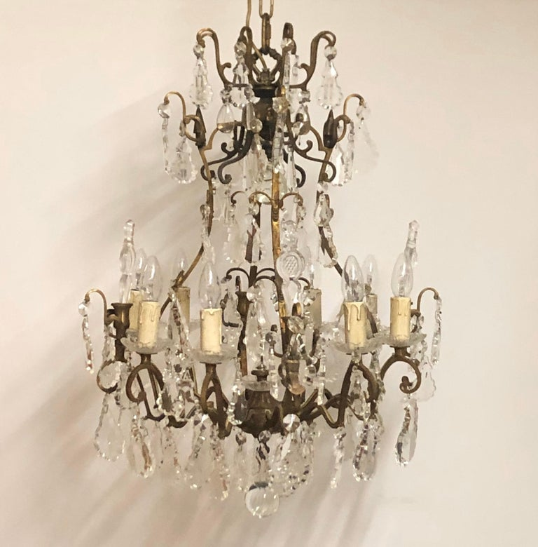 Beautiful eight -light massiv bronze and crystal glass chandelier, France, circa 1970s. Pair available. The height incl. chain is 55.11