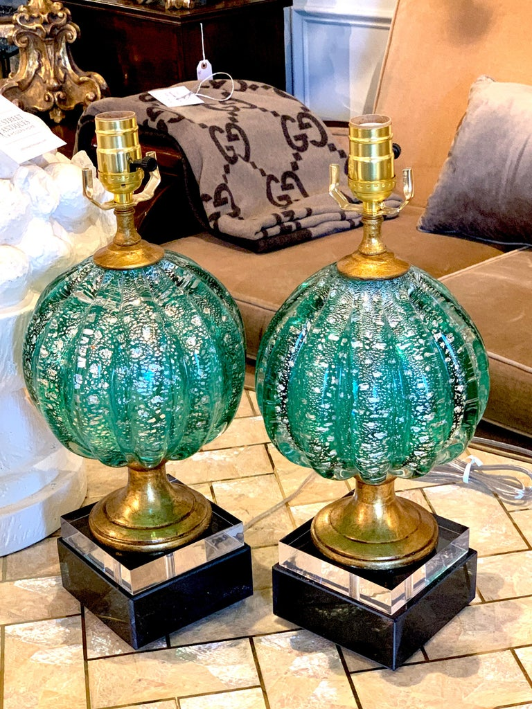 Stunning pair of green and silver infused Murano glass orb lamps, each one magnificent ribbed and luminescent hand blown Murano glass, raised on 5