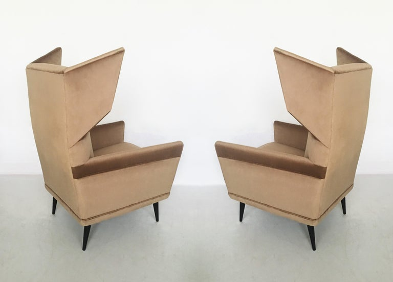Stunning pair of chairs designed by the Italian designer Gio Ponti. Completely restored and newly upholstered with silk velvet, ebonized conical wood legs.  Model Bergere from the Hotel 'Parco dei Prinicipi' Rome Produced by Cassina, circa