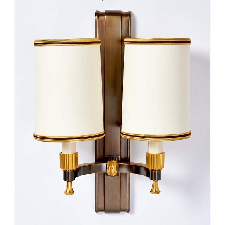 Maxime Old (1910-1991) Stunning pair of gilt and oxidized bronze sconces with fluted mounts by Maxime Old France, 1940s Ref: Yves Badetz, Maxime Old, p.109, for this model TWO PAIR AVAILABLE  Sold and priced by the pair Dimensions: 12.5 W x 7.5 D x