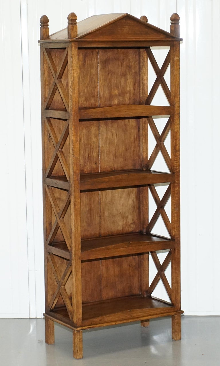 We are delighted to offer for sale this lovely pair of steeple top bookcases in solid wood  A very well made and decorative pair of open bookcases, great for displaying trinkets  We have cleaned waxed and polished them from top to bottom, they