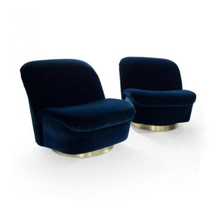 Stunning, highly sculptural lounge chairs designed by Vladimir Kagan for Directional Design. Amazingly comfortable expertly restored, recovered in a gorgeous royal blue velvet. They swivel, tilt and rock a bit on newly fitted round brass bases.