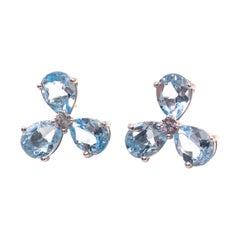 Stunning pair of Three-petal Genuine Blue Topaz Flower Earrings