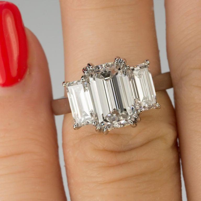 Women's or Men's Stunning Platinum Three Emerald Cut Diamond Ring For Sale