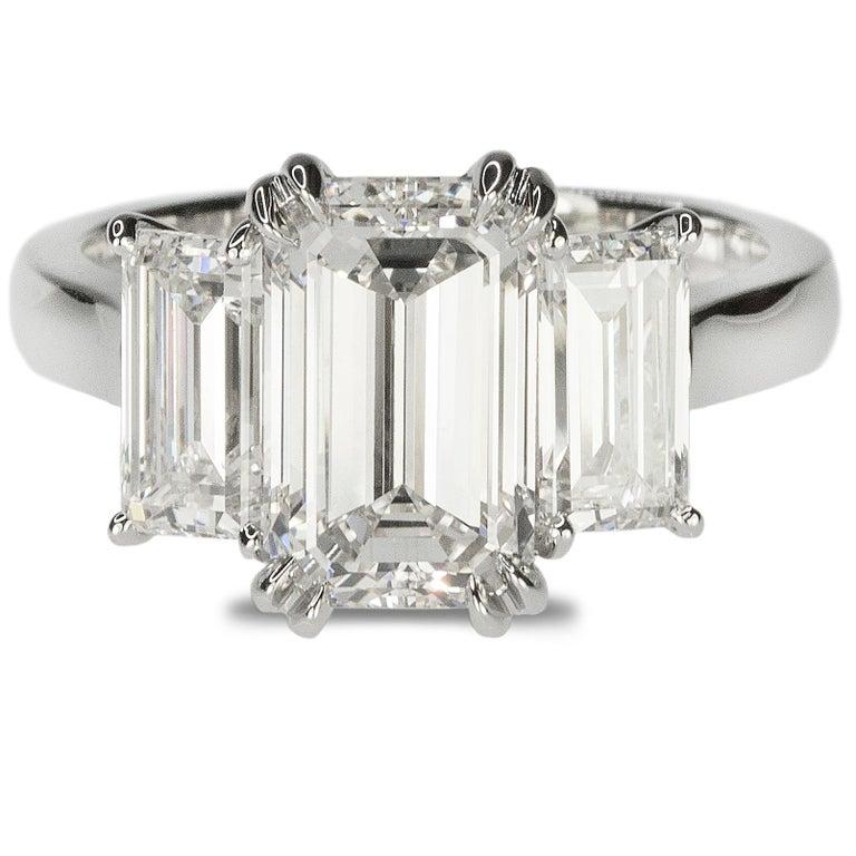 Stunning Platinum Three Emerald Cut Diamond Ring For Sale 2