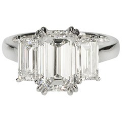 Stunning Platinum Three Emerald Cut Diamond Ring