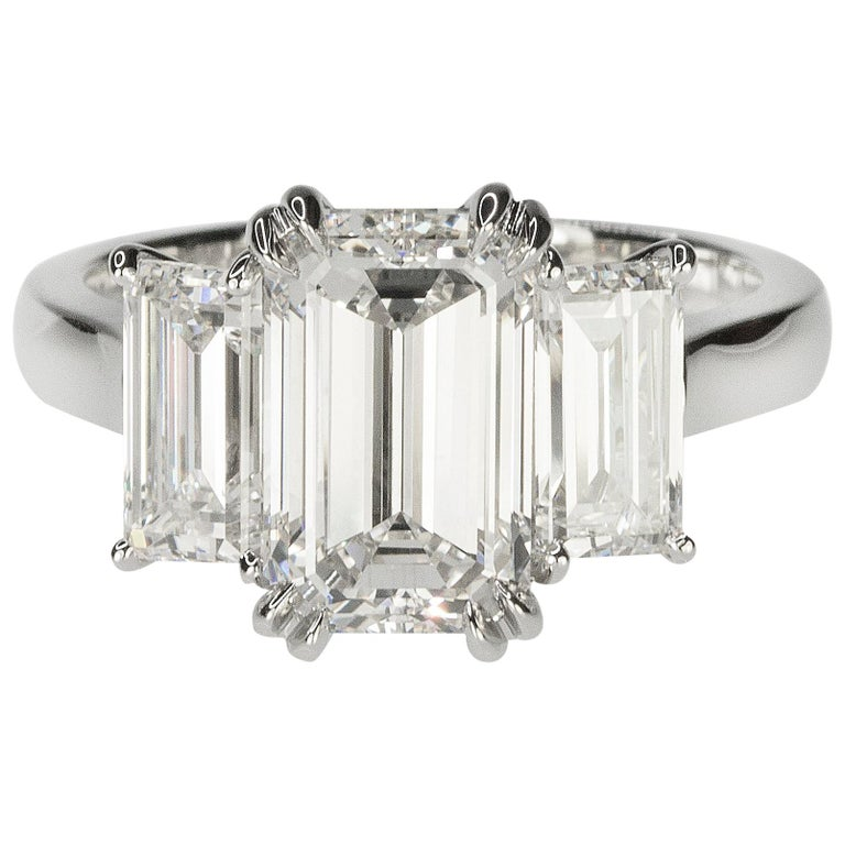 Stunning Platinum Three Emerald Cut Diamond Ring For Sale