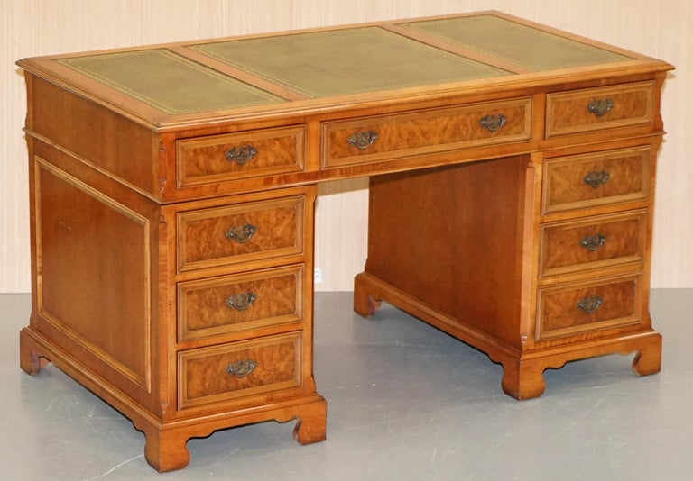 We are delighted to offer for sale this stunning burr walnut twin pedestal partner desk with green leather top and custom made to order drawer tops to be used as butlers trays or mouse shelves  A very good looking and well made desk, there are