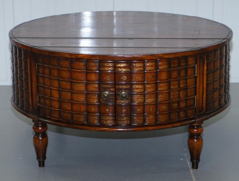 We are delighted to offer for sale this stunning rare Theodore Alexander Regency Drum table Faux Scholars books coffee table with a pair of cupboards 