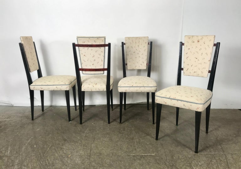 Stunning set of 12 Italian modernist dining chairs attributed to Osvaldo Borsani, Classic modern design, fit seamlessly into any modern, antique, traditional or contemporary environment. Black lacquer frames with amazing burl wood back detail, Can