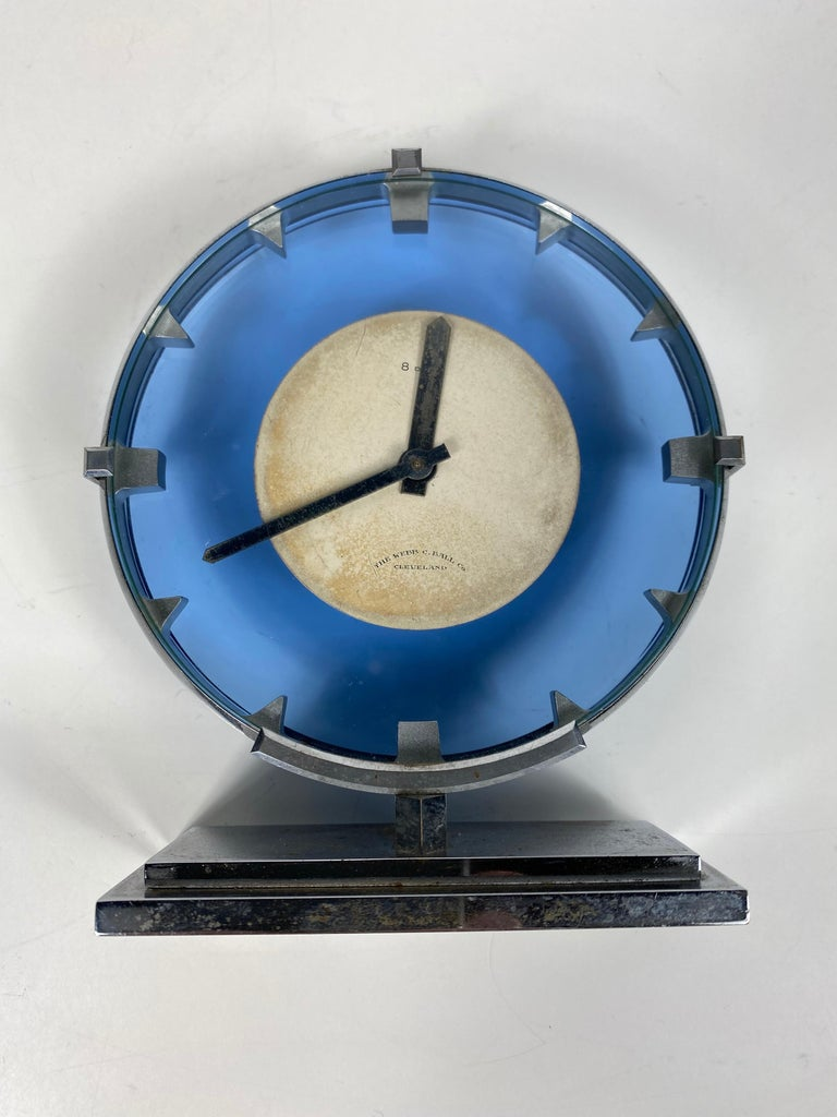 Stunning stainless steel and blue glass Art Deco / Machine Age clock manufactured by The Webb C.Ball co...Cleveland, wind up 8 day table clock, Classic modernist design.. runs and keeps perfect time.  The WEBB C. BALL CO. was one of Cleveland's