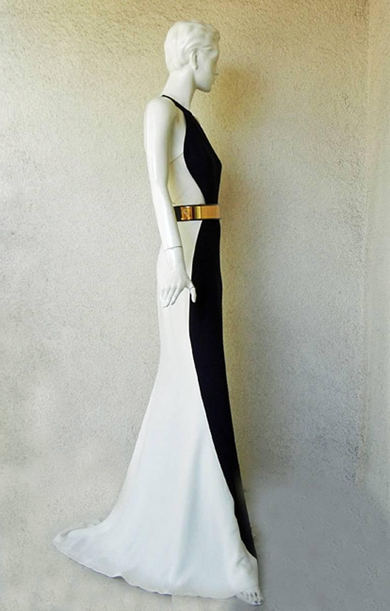 One of the best pieces I've seen from Stella McCartney. Seen at the Emmy's and was a drop-dead knockout! Elegance and high fashion at its best!   This colorblock standout gown features racer back navy-blue and off-white bias cut silk gown; nude mesh