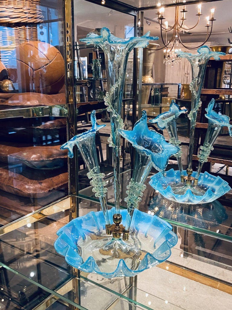 Seldom seen and spectacular vintage Italian Murano glass centrepiece set with bowl and 3 vases, circa 1950s. The glass is both mouth-blown and handmade and very artfully made using transparent and turquoise coloured opaque glass with frilled
