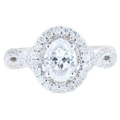 Stunning Twisted Shank Oval Diamond Engagement Ring with Diamond Pave
