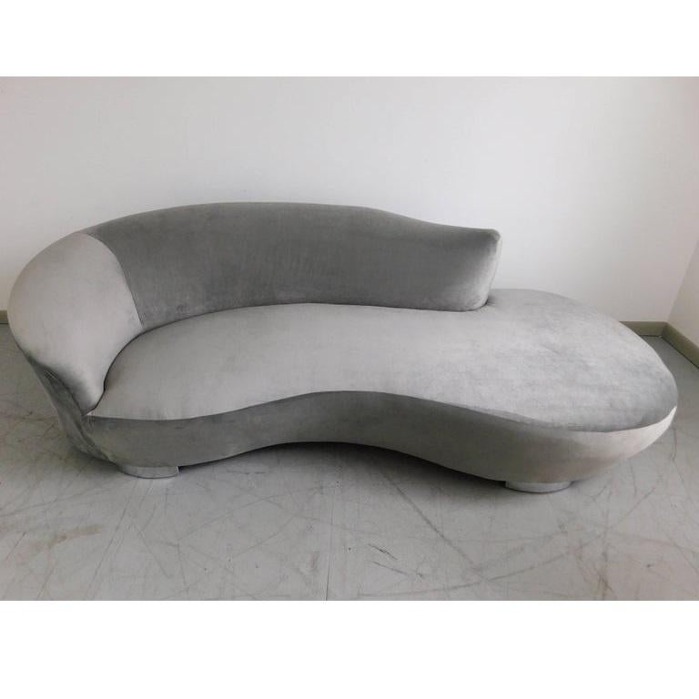 This gorgeous biomorphic shape sofa in a coveted design has been fully restored in grey velvet. It's unique shape and curved chrome feet give the sofa a wonderful floating effect.