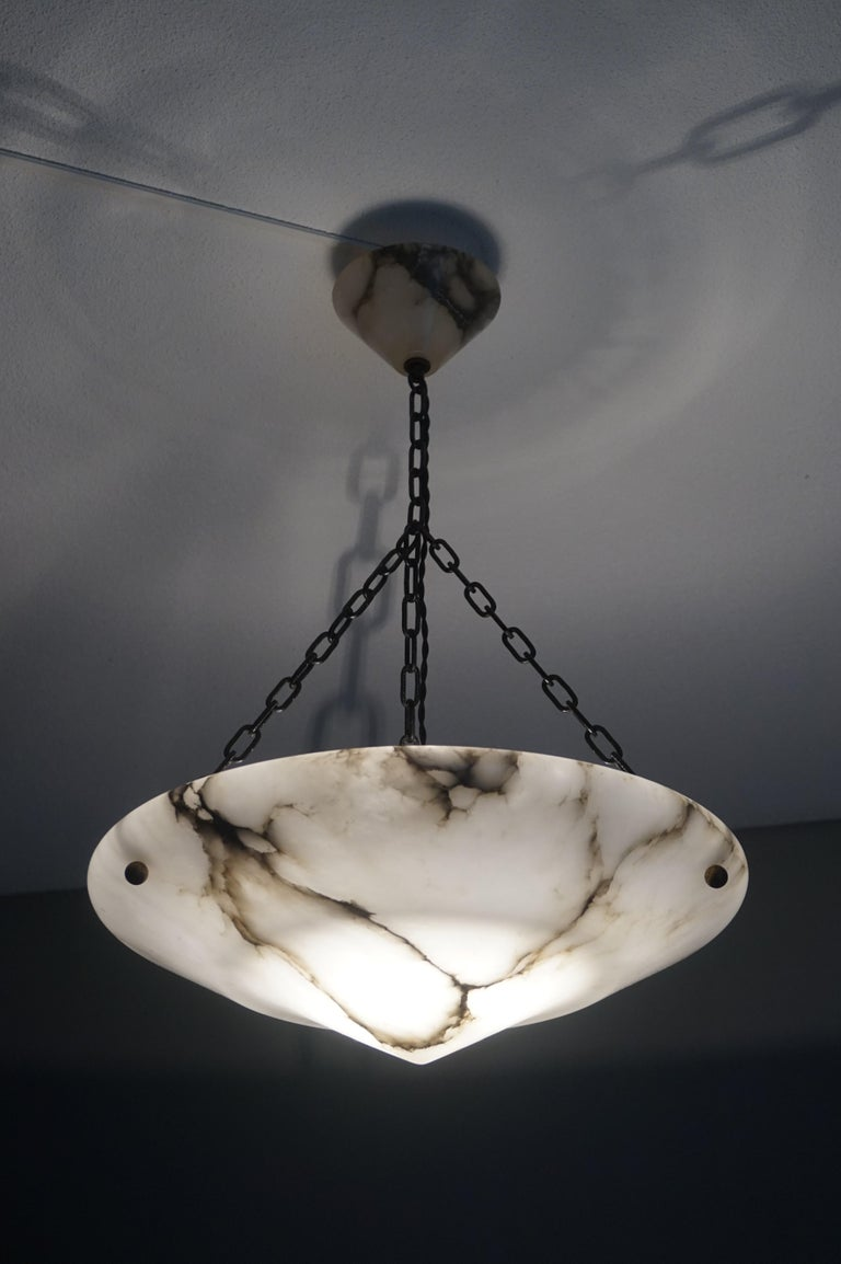 Perfect size, great design and superb condition Art Deco light fixture.  With early 20th century lighting being one of our specialties, we were immediately impressed with the size, shape and excellent condition of this alabaster chandelier. Over the