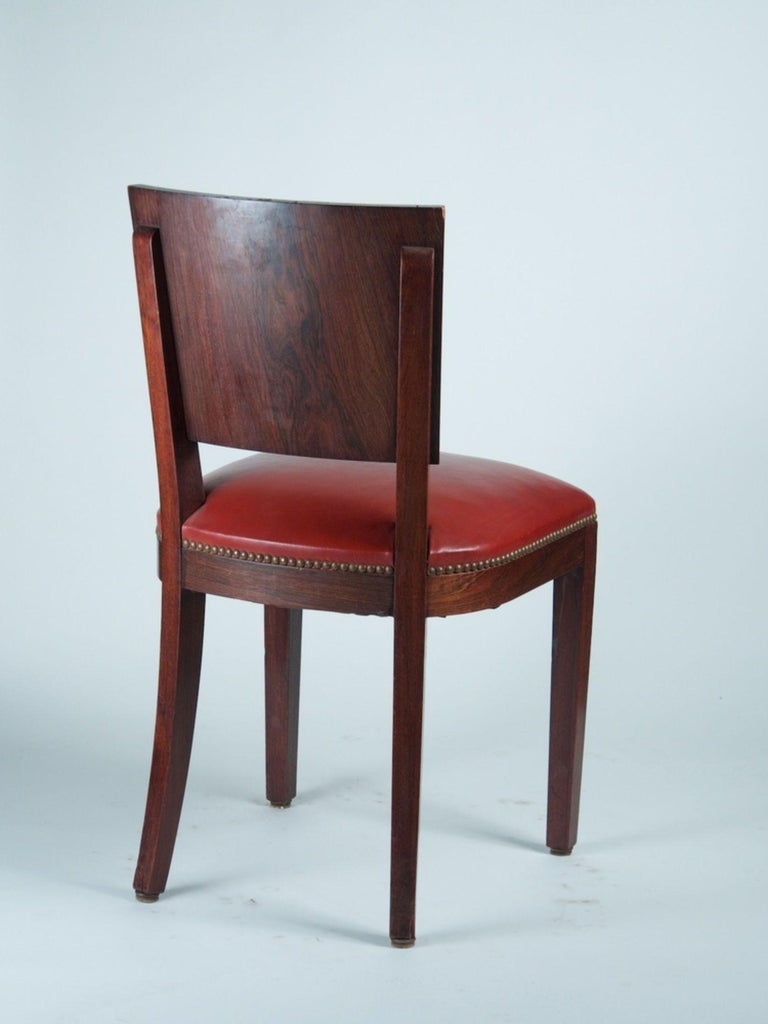 French Modernist Art Deco dining chairs in the style of DIM. Set of 6 in rosewood and mahogany. Measures: 18