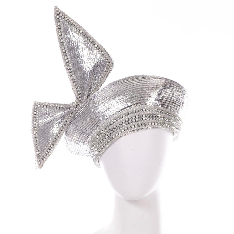 This is the perfect statement had from the 1960's designed by Jack McConnell. We love the small silver beads and crystal embellishments. This hat is a turban style with a big asymmetrical structured bow. The hat has the coveted Styled by Jack