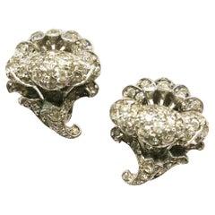Stylised clear paste and metal 'flower' earrings, Ciro, London, c1950s