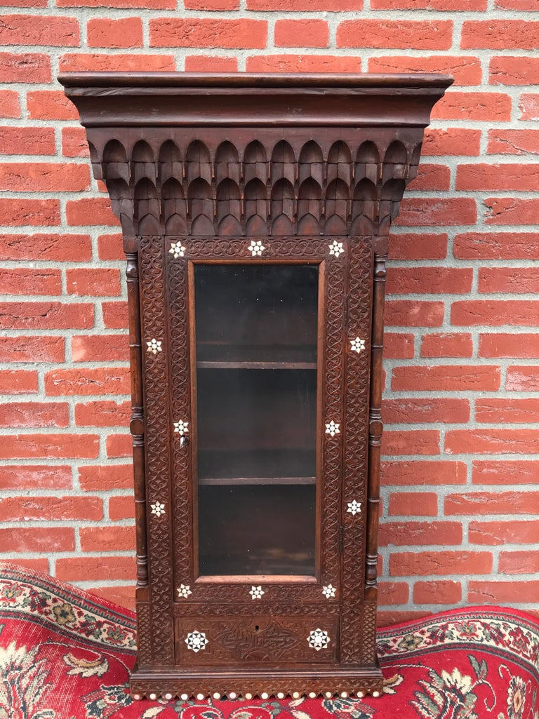 Stylish Antique Eastern Style Wooden Wall Hanging Cabinet with Intricate Details For Sale 2