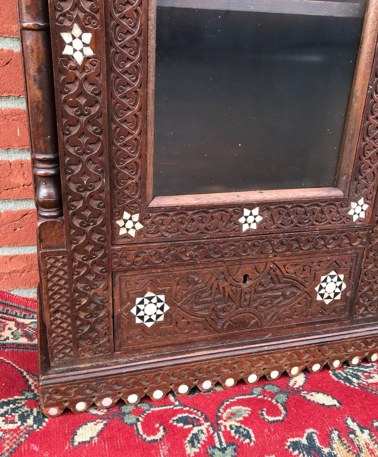 Stylish Antique Eastern Style Wooden Wall Hanging Cabinet with Intricate Details For Sale 8