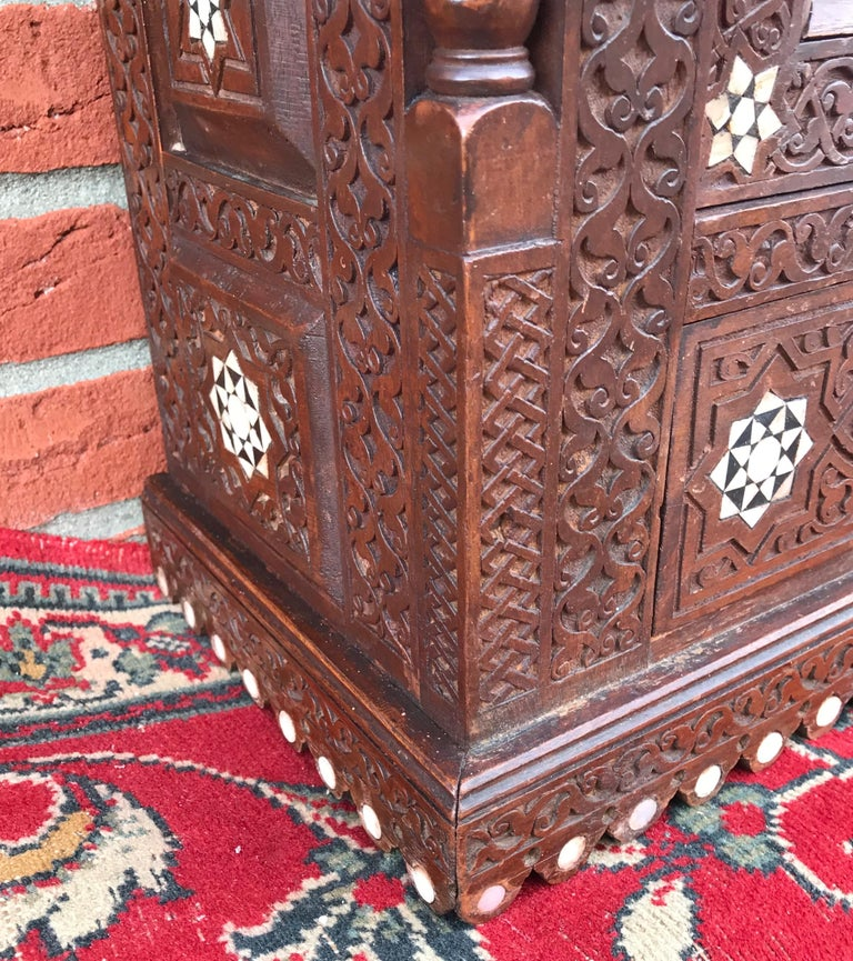 Stylish Antique Eastern Style Wooden Wall Hanging Cabinet with Intricate Details For Sale 9