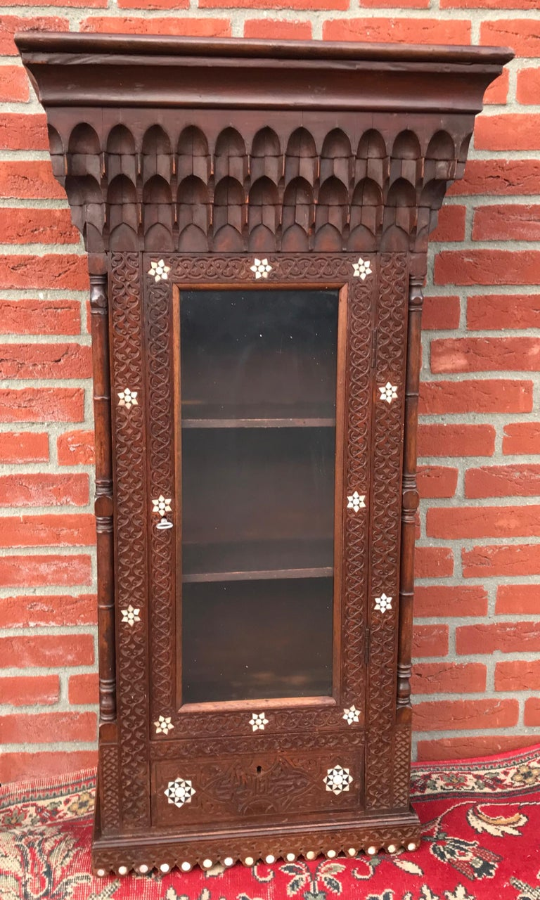Stylish Antique Eastern Style Wooden Wall Hanging Cabinet with Intricate Details For Sale 11